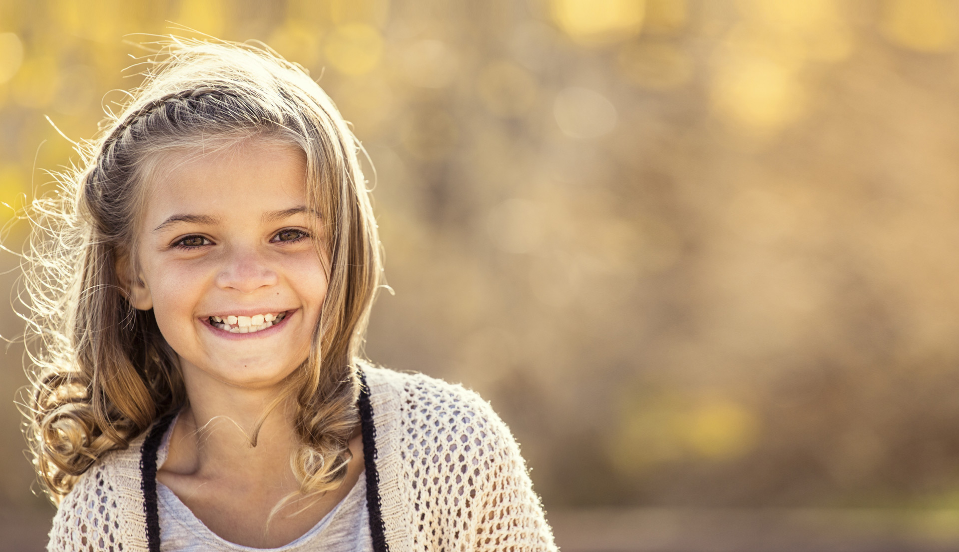Young girl smiling with healthy teeth