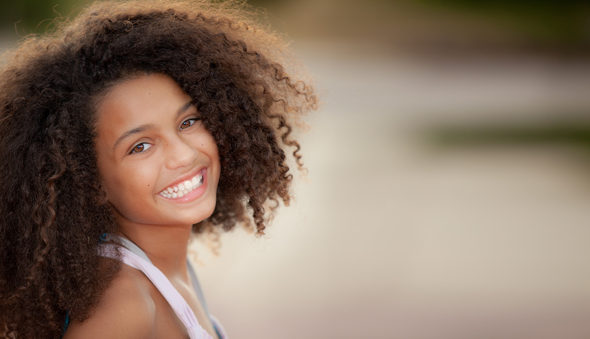 Young African American girl smiling with healthy teeth